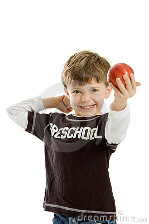 Preschool boy with apple