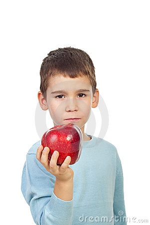 Preschool boy holding red apple