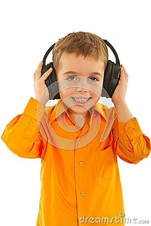 Preschool boy listening music