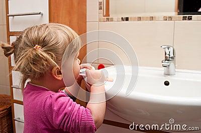 Preschool girl brushing teeth