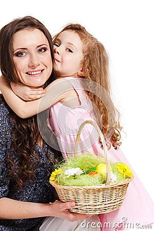 Preschool girl embracing her mom