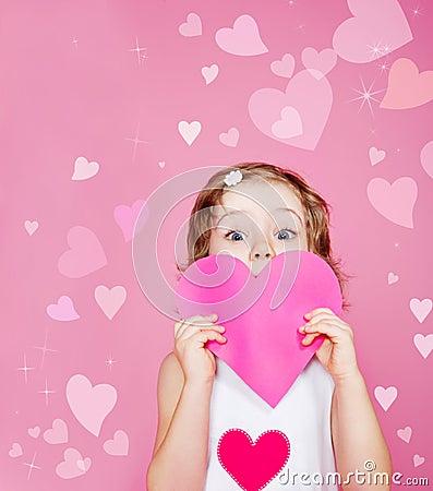 Preschool girl holding paper heart