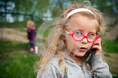 Preschool girl with telephone