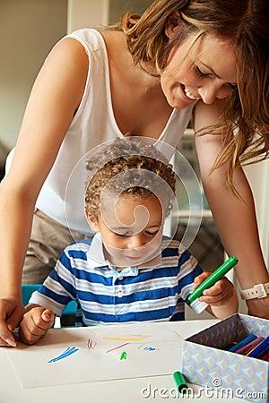 Preschool Teacher Looking at the Kid s Drawing