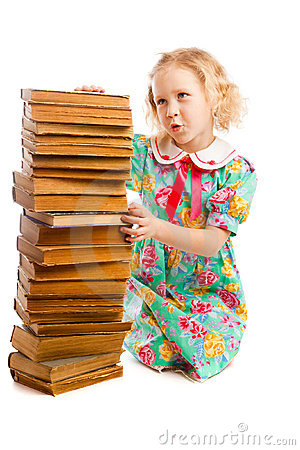 Preschooler with books stack
