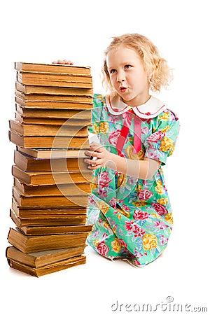 Preschooler with books stack