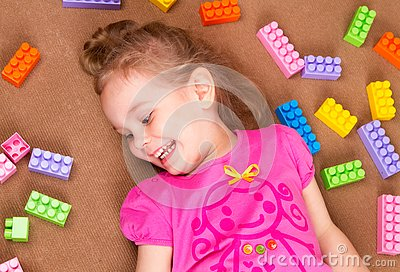 Preschooler child playing with colorful toy blocks Stock Photo