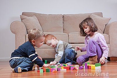 Preschooler children playing with toy blocks