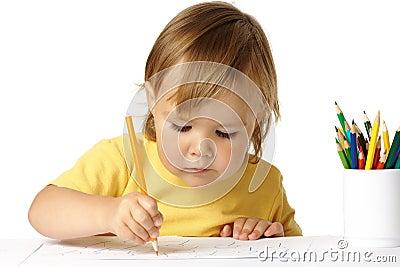 Preschooler focused on her drawing