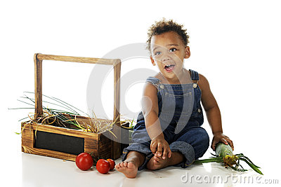 Preschooler with Garden Veggies