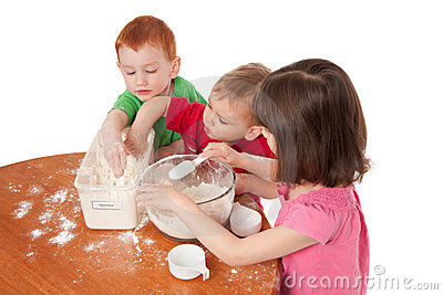 Preschooler kids making mess in kitchen