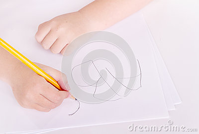 Preschooler learning to write alphabet