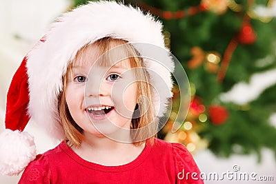 Preschooler in Santa hat