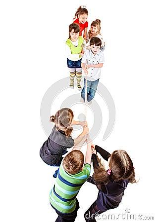 Preschooler teams pulling rope