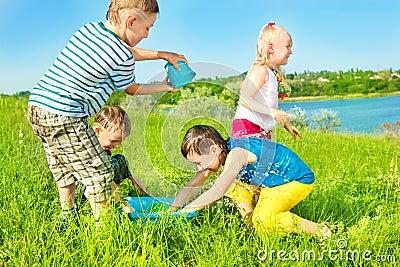 Preschoolers spreading water