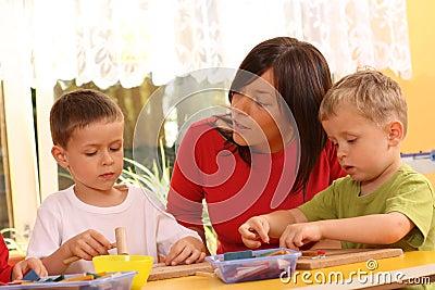 Preschoolers with wooden block