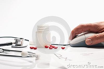 Prescription medicine and pharmacist hand on compu