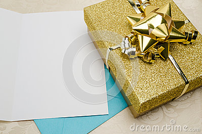 A Present Wrapped in Gold with a Card