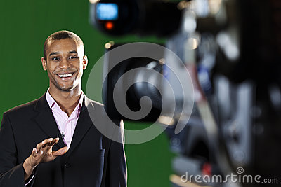 Presenter in TV Studio with foreground camera