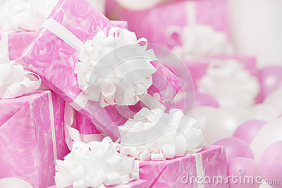 Presents gift boxes, pink background for female or woman birthda