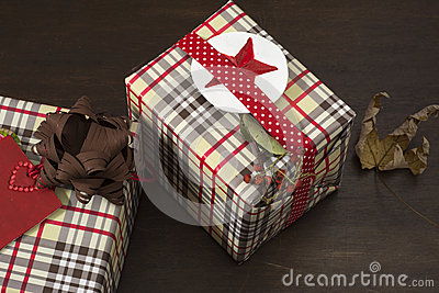 Presents wrapped in checkered paper and brown ribbon with label