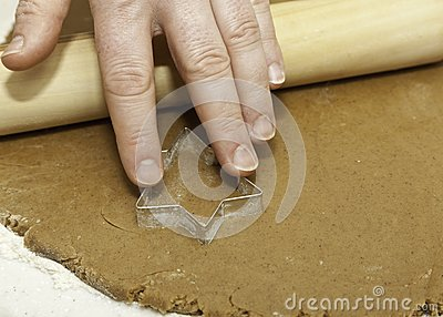 Pressing cookie cutter into dough