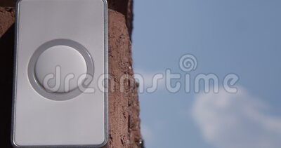 Pressing Doorbell with Man and Woman Finger and Red Nails on a Blue Sky on Sunny Day.  stock video footage