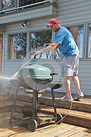 Pressure washing outdoor barbecue