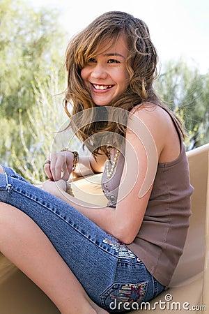 Preteen Female On Playground Slide