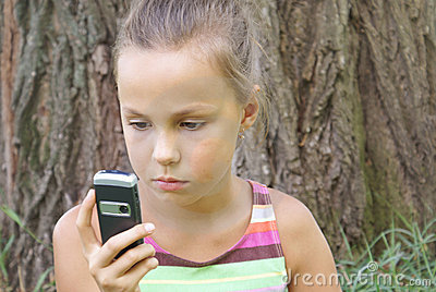 Preteen girl with cell phone