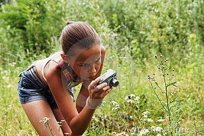 Preteen girl with digital camera