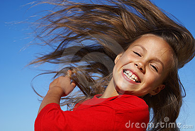 Preteen girl flipping hair