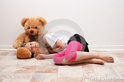 Preteen girl with her teddy bear