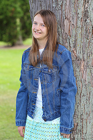 Preteen girl in jean jacket