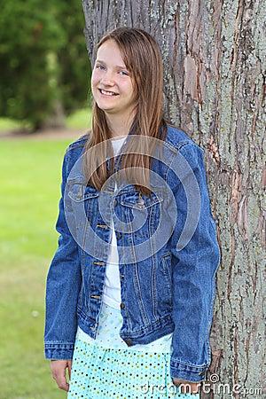 Preteen girl in jean jacket