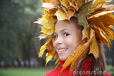 Preteen girl in leaf garland