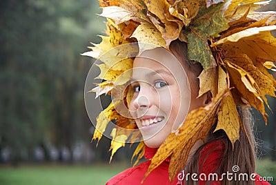 Preteen girl in leaf garland