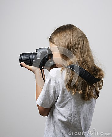 Preteen girl photographing