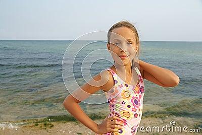 Preteen girl on sea beach stock photo. Image of caucasian