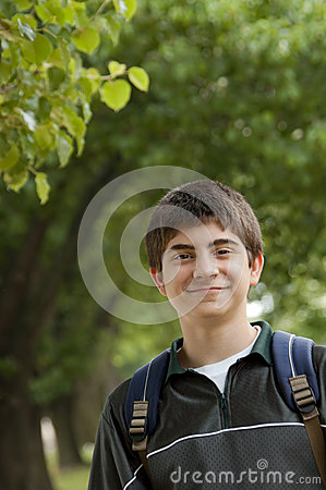 Preteen school boy wearing backpack