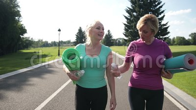 Pretty adult women going to training in the park stock footage
