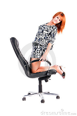 Pretty alluring young girl on armchair