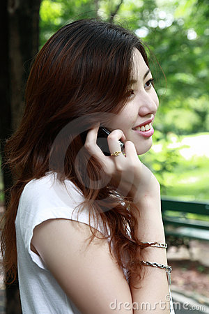 Pretty asia girl talking on the phone