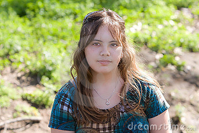 Pretty Asian/Caucasian teenager outdoors