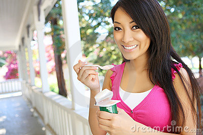 Pretty Asian Woman Eating Yogurt