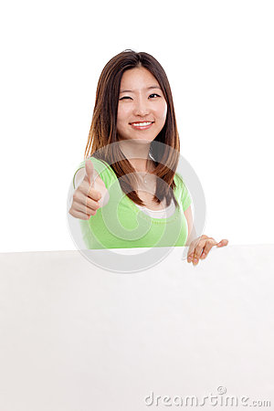 Pretty asian woman holding a penel and show thumb