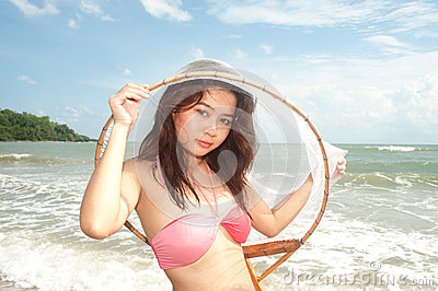 Pretty Asian woman joyfully with fishing scoop net .