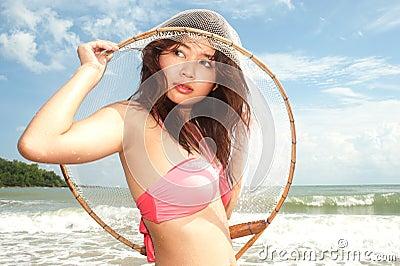 Pretty Asian woman joyfully with fishing scoop net .
