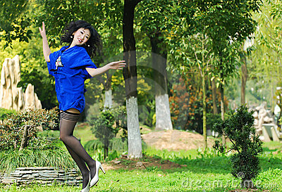 Pretty asian woman jumping