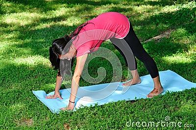Pretty Asian woman - yoga in the park